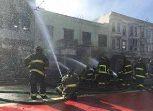 firefighters spraying water Mission Street fire