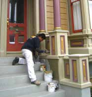 Todd painting a home